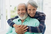 Portrait close up of African-American  couple hugging each other inside a room. Authentic Senior Ret poster