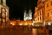 PRAGUE - JULY 05: Old Town Square with people, illuminated buildings and Tyn Church on background at evening. The square is very popular with tourists  in Prague, Czech Republic on July 05, 2004.