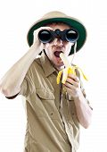 Explorer With Binoculars Eating Banana