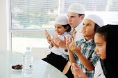 image of dua  - Muslim father praying with kids for Ramadan - JPG