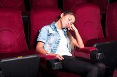 attractive woman asleep in the cinema