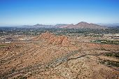 stock photo of piestewa  - The Red Rocks of Phoenix Arizona at Papago Park with Camelback Mountain and Piestewa Peak in the distance - JPG