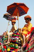 Two young cameleers preparing to take part at decoration competition at camel fair in Pushkar