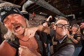 Geek Punches Man In Bar