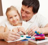 image of molding clay  - Father play with child at home - JPG