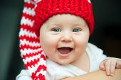 pretty child of tender years in red hat smiling