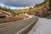picture of mph  - Mile one of a Montana frontage road promises to be interesting with an immediate warning for a 30 mph curve ahead and beautiful scenery - JPG