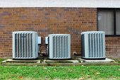 three industrial sized air conditioners