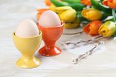 Eggs in orange and yellow eggcups