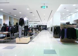 stock photo of department store  - In a light empty modern clothes shop - JPG