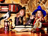 Witch  children with crystal ball. Halloween.