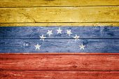 venezuelan flag on wood texture background