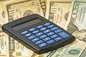 Electronic Calculator And USA Dollar Banknotes.