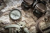 vintage  still life with compass,sextant and old map.
