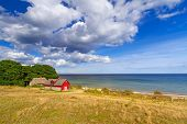 Red cottage house at Baltic Sea in Sweden