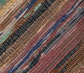 Closeup Of Old Worn Out Striped Rag Rug