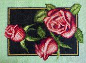 stock photo of gobelin  - Gobelin of red roses with green leaves on dark - JPG