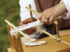 foto of handloom  - close up od ancient little loom and hands - JPG