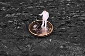 Miniature Figure Businessman  On Euro