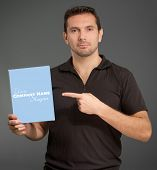 Portrait of a man pointing at a blank box