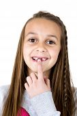 stock photo of missing teeth  - Cute girl pointing at missing front teeth - JPG