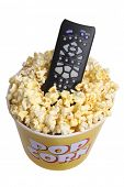Remote control in popcorn bucket on white