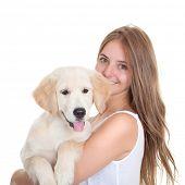 young woman holding labrador pet dog