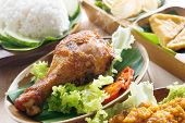 Popular Indonesian local food nasi ayam penyet, indonesian fried chicken rice with sambal belacan. F