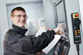manufacture technician worker operating metal machining center at factory shop