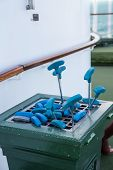 picture of miniature golf  - Blue putters in a rack at a miniature golf course - JPG