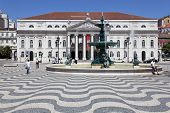 Lisbon, Portugal - April 26, 2013: Dona Maria II National Theatre and fountain in Rossio (Dom Pedro