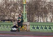 Man Playing Bagpipes  On Westminster Bridge
