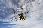 foto of drone  - Takingaero photo using octocopter flying drone with slr camera - JPG