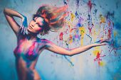 stock photo of aura  - Young woman muse with creative body art and hairdo - JPG