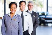 multiracial vehicle sales team inside car showroom