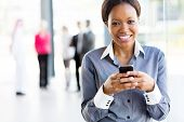 african businesswoman using smart phone in modern office