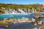 stock photo of incredible  - Hraunfossar is a very beautiful Icelandic waterfall in the west of the island - JPG