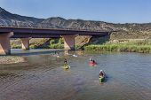 DOTSERO, CO - AUGUST 19: Stand up paddleboards, kayaks and canoes in the annual Colorado River Race