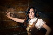 stock photo of role model  - Portrait of a young woman wearing a steampunk outfit - JPG