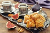 pic of baklava  - Cup of coffee with baklava and metal oriental tray on wooden background - JPG