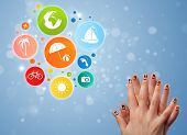 Cheerful happy smiling fingers with colorful holiday travel bubble icons