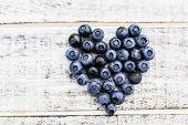 Blueberries - fresh blueberries on wooden background