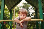 Cute Happy Little Boy Leaning On A Railing