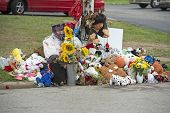 FERGUSON, MO/USA - AUGUST 30, 2014: A makeshift memorial near where black teenager Michael Brown was shot to death by police in Ferguson, Missouri.