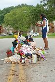 FERGUSON, MO/USA - AUGUST 30, 2014: A woman at makeshift memorial where black teenager Michael Brown was shot to death by police in Ferguson, Missouri.