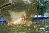 Joyful Girl To Dunk In A Transparent Ball