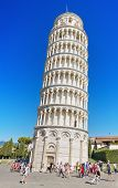 Tourist visiting famous Italian landmark Pisa tower on August 21 2013.
