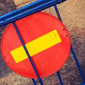 picture of no entry  - Round red sign No Entry mounted on blue road barrier - JPG