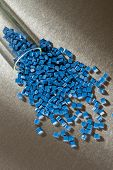 blue polymer pellets on metal sheet