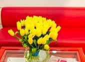 Vase of yellow tulips in modern  living room